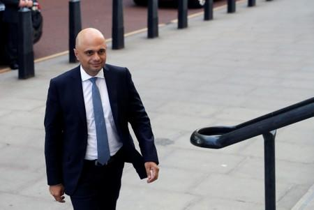 Britain's new Chancellor of the Exchequer Sajid Javid arrives at the treasury in London