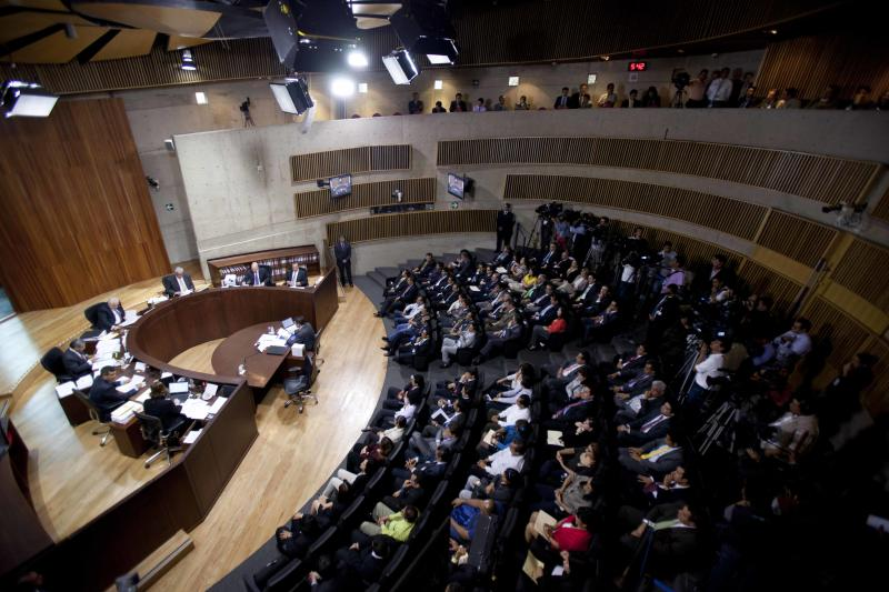 Members of the Federal Electoral Tribunal attend a session in Mexico City, Thursday, Aug. 30, 2012. Three of the seven justices on Mexico's highest election court, the Federal Electoral Tribunal, recommended Thursday dismissing legal challenges mounted by the second-place leftist candidate that seek to overturn the results of the July 1 presidential elections. (AP Photo/Eduardo Verdugo)