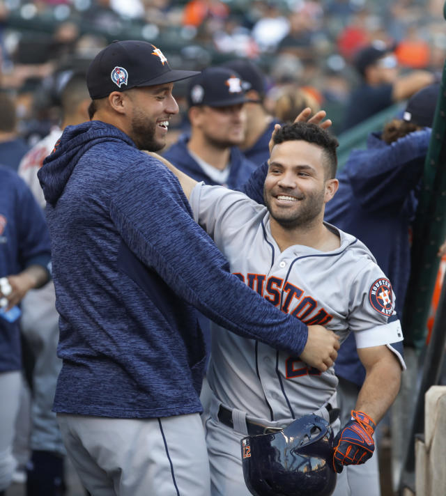 Houston Astros' Jose Altuve, right, celebrates his leadoff solo home run with George Springer in the first inning of a baseball game against the Detroit Tigers in Detroit, Tuesday, Sept. 11, 2018. (AP Photo/Paul Sancya)