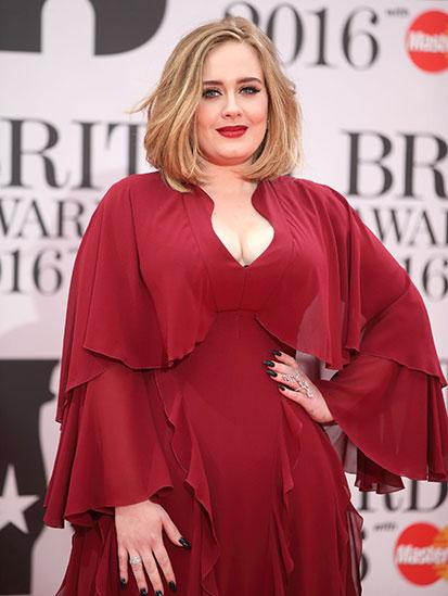 Adele in a red dress at the Brit Awards in 2016.