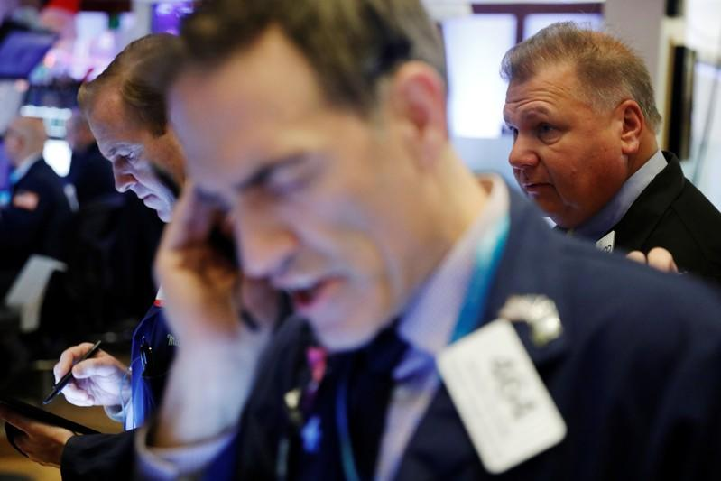 Traders work on the floor of the New York Stock Exchange shortly after the opening bell in New York City