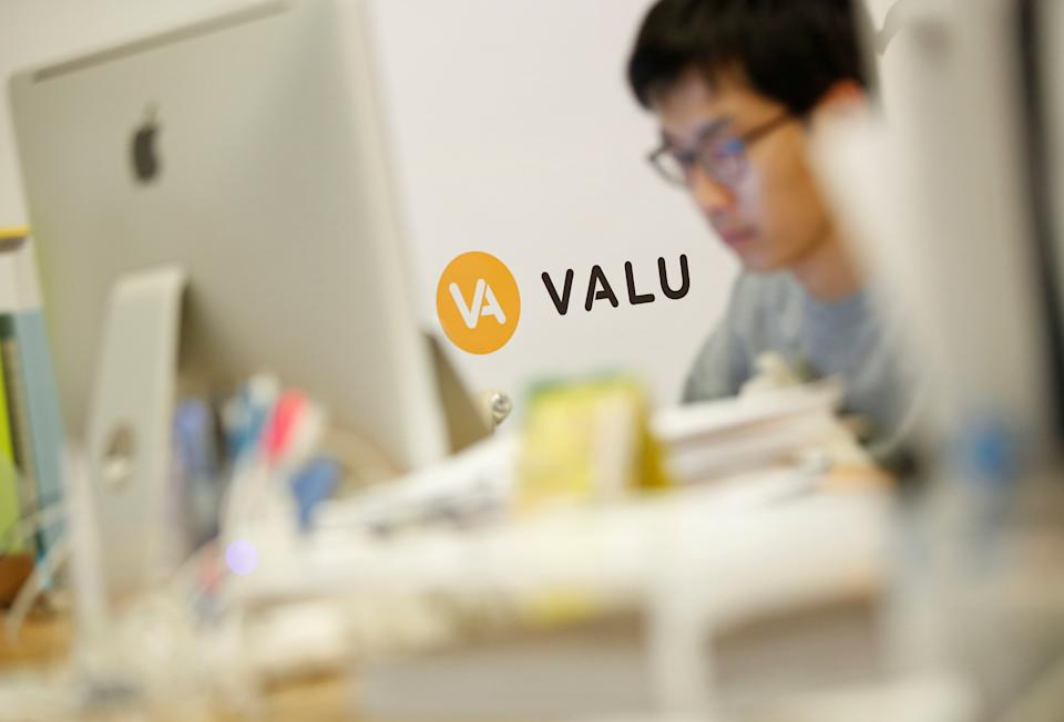 A man works at the company office running Valu, web-based virtual exchange where people can raise bitcoins by 'listing themselves', in Tokyo, Japan July 26, 2017. Picture taken July 26, 2017.  REUTERS/Issei Kato