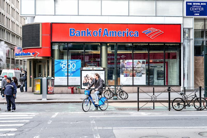 New York, USA - April 7 , 2018: America branch in NYC with people waiting, pedestrian walking, crosswalk, bike, road in Manhattan