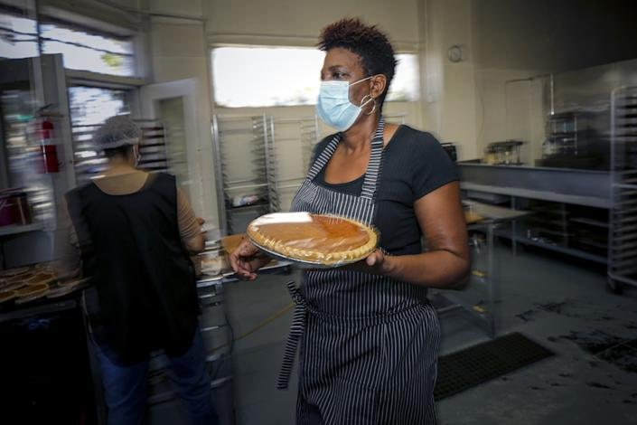 Jeanette Bolden-Pickens, owner of 27th Street Bakery Shop in South L.A., prepares pies.