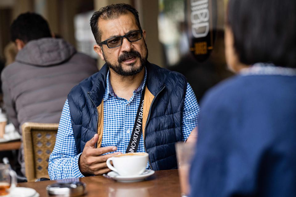 Sayed Sadaat, former communications minister in Afghanistan, gives an AFP interview in Leipzig, eastern Germany on August 29, 2021. - Sadaat, minister in Afghanistan from 2016 to 2018, quit, fed up with the corruption. Now in Germany, he is making a living delivering meals as a bicycle courier. - TO GO WITH AFP STORY by Hui Min NEO (Photo by JENS SCHLUETER / AFP) / TO GO WITH AFP STORY by Hui Min NEO (Photo by JENS SCHLUETER/AFP via Getty Images)