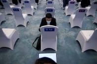 People check laptop at the opening ceremony of the World Internet Conference (WIC) in Wuzhen