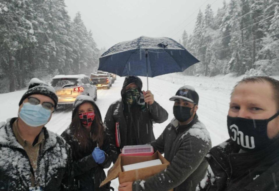 Health workers administer COVID vaccine to motorists stuck in snow storm