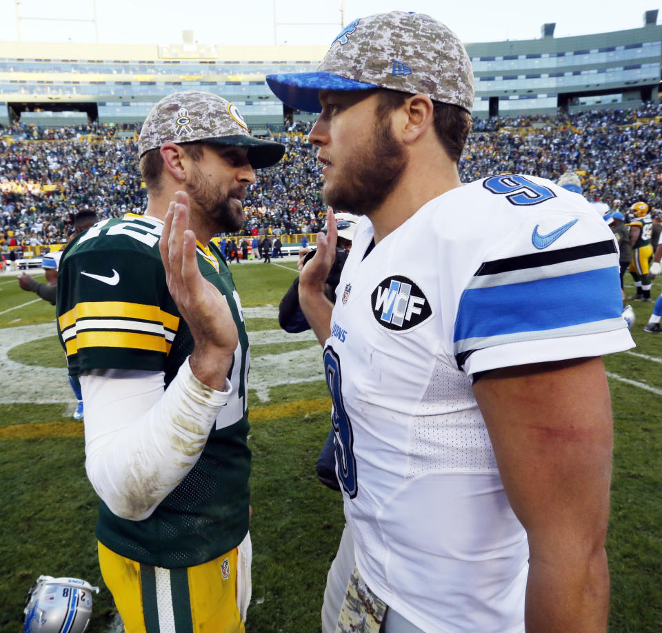 FILE - In this Nov. 15, 2015 file photo, Green Bay Packers' Aaron Rodgers talks to Detroit Lions' Matthew Stafford after an NFL football game in Green Bay, Wis.  Rodgers has been struggling a bit this season while Stafford is in one of his best grooves. The quarterback  who plays best Thursday, Dec. 3 will likely help his team win at Ford Field. (AP Photo/Mike Roemer)