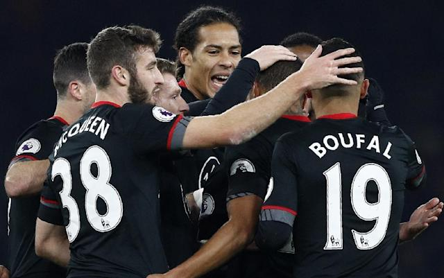 Teammates congratulate Southampton's Jordy Clasie after he scored his team's first goal against Arsenal at the Emirates Stadium in London on November 30, 2016 (AFP Photo/Adrian Dennis)