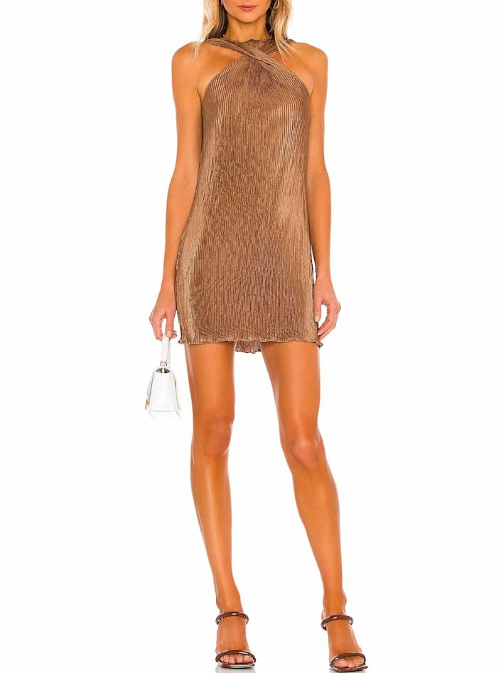 """The cross-neck, the texture, the rich hue? Alexa, play """"Golden"""" by Harry Styles. $135, Revolve. <a href=""""https://www.revolve.com/song-of-style-pluto-mini-dress/dp/SOSR-WD134/"""" rel=""""nofollow noopener"""" target=""""_blank"""" data-ylk=""""slk:Get it now!"""" class=""""link rapid-noclick-resp"""">Get it now!</a>"""