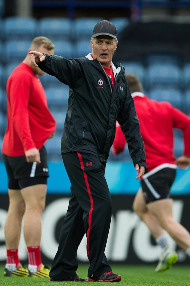 Canada's New Zealander coach Kieran Crowley gestures during a captain's run training session in Leicester, central England, on October 5, 2015, on the eve of their 2015 Rugby Union World Cup match against Romania. AFP PHOTO / BERTRAND LANGLOIS RESTRICTED TO EDITORIAL USE (AFP Photo/BERTRAND LANGLOIS)