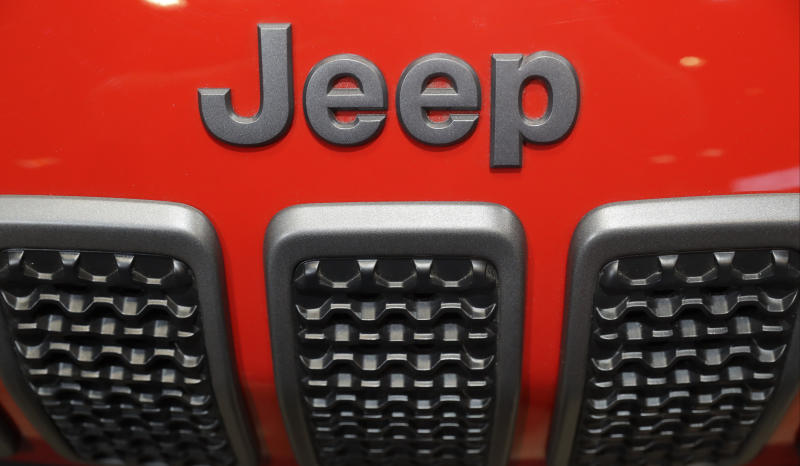 """FILE- In this Feb. 8, 2018, file photo, a Jeep Cherokee sits on display at the Chicago Auto Show in Chicago. Trout Unlimited President and CEO Chris Wood, the head of one of the nation's largest fish conservation groups, said Wednesday, Feb. 14, that Fiat Chrysler Super Bowl ads """"glorified"""" the destruction of aquatic habitat in an apparent attempt to appeal to off-road thrill seekers. (AP Photo/Charles Rex Arbogast, File)"""