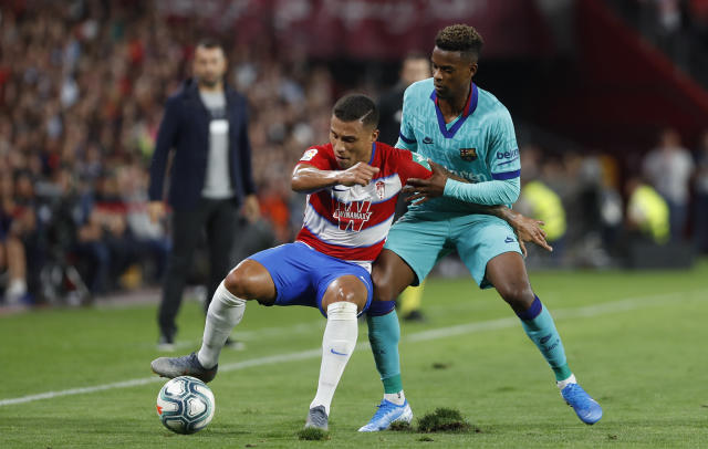 Barcelona's Nelson Semedo, right, and Granada's Darwin Machis fight for the ball during the Spanish La Liga soccer match between Barcelona and Granada at the Los Carmenes stadium in Granada, Spain, Saturday, Sept. 21, 2019. (AP Photo/Miguel Morenatti)