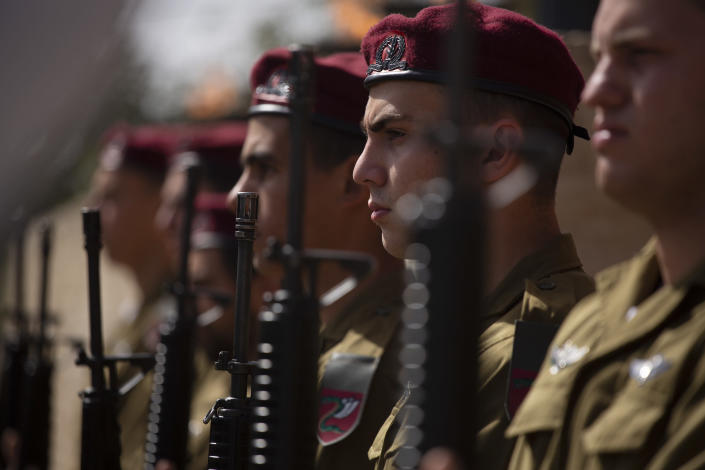 A military honor guard stands in formation at a ceremony marking the annual Holocaust Remembrance Day, at Yad Vashem Holocaust Memorial in Jerusalem, Thursday, April 8, 2021. (AP Photo/Maya Alleruzzo, Pool)