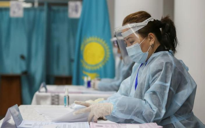 People vote during Kazakhstan's parliamentary election in Almaty