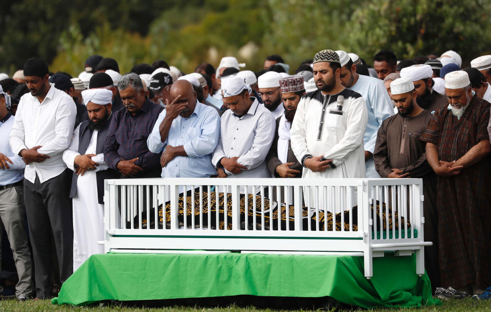 Mourners pray at the graveside of a Christchurch shooting victim. Source: AP