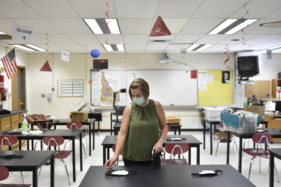 Science teacher Camille Flournoy set out masks for her students on Aug. 18 in Twin Falls, Idaho. Flournoy and other teachers are now officially considered