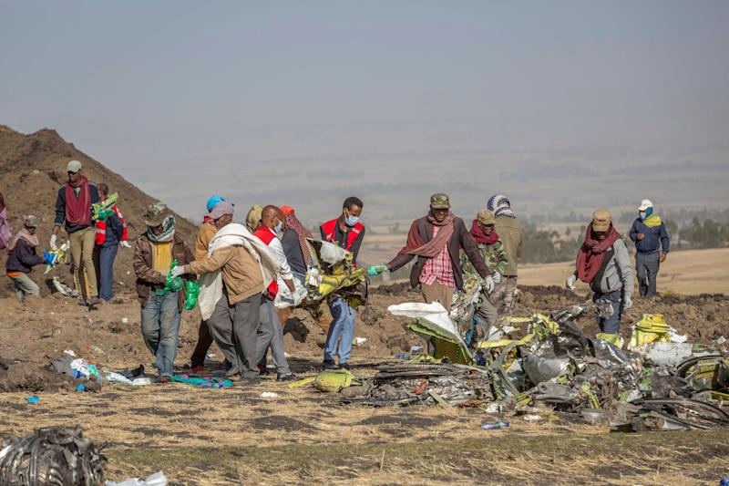 Rescuers work at the scene of an Ethiopian Airlines flight crash near Bishoftu, or Debre Zeit, south of Addis Ababa, Ethiopia, March 11, 2019. (Photo: Mulugeta Ayene/AP)