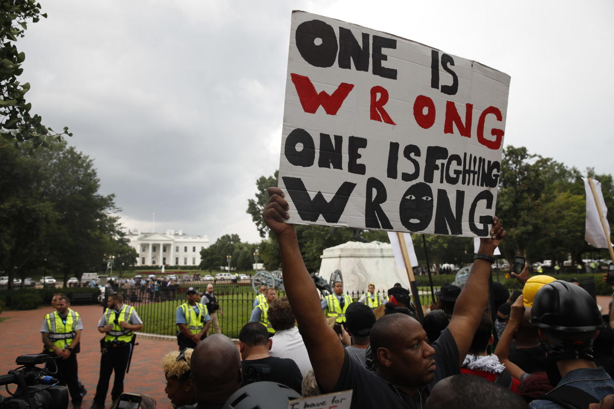 Demonstrators march near the White House on the one-year anniversary of the Unite the Right rally in Charlottesville, Va. (Photo: Jacquelyn Martin/AP)