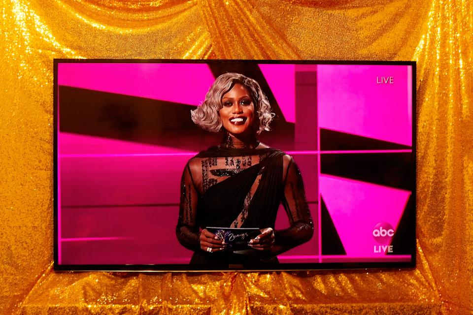 <h2>Laverne Cox</h2><br><br>Laverne Cox stunned while presenting at the 2020 Emmys in a super-dark oxblood red lipstick that'll look great with a cozy sweater and a bottle of merlot.