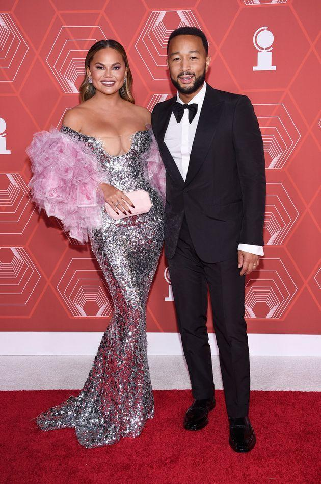 Chrissy Teigen, left, and John Legend arrive at the 74th annual Tony Awards at Winter Garden Theatre on Sunday, Sept. 26, 2021, in New York. (Photo by Evan Agostini/Invision/AP) (Photo: via Associated Press)