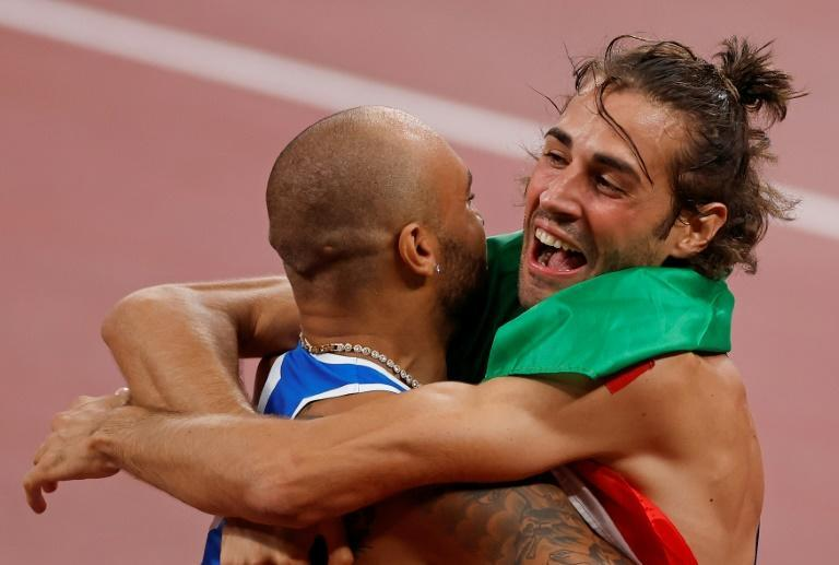 Lamont Marcell Jacobs celebrated his 100m title with fellow Italian Gianmarco Tamberi who shared the gold in the high jump