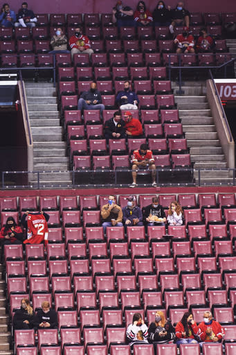 Fans watch the first period of an NHL hockey game between the Florida Panthers and the Chicago Blackhawks on Tuesday, Jan. 19, 2021, in Sunrise, Fla. Not only are the Panthers still unbeaten after two games but theyre also leading the NHL in attendance. (AP Photo/Marta Lavandier)
