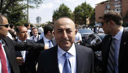 Turkish Foreign Minister Mevlut Cavusoglu leaves Kocatepe Mosque after Friday prayers in Ankara
