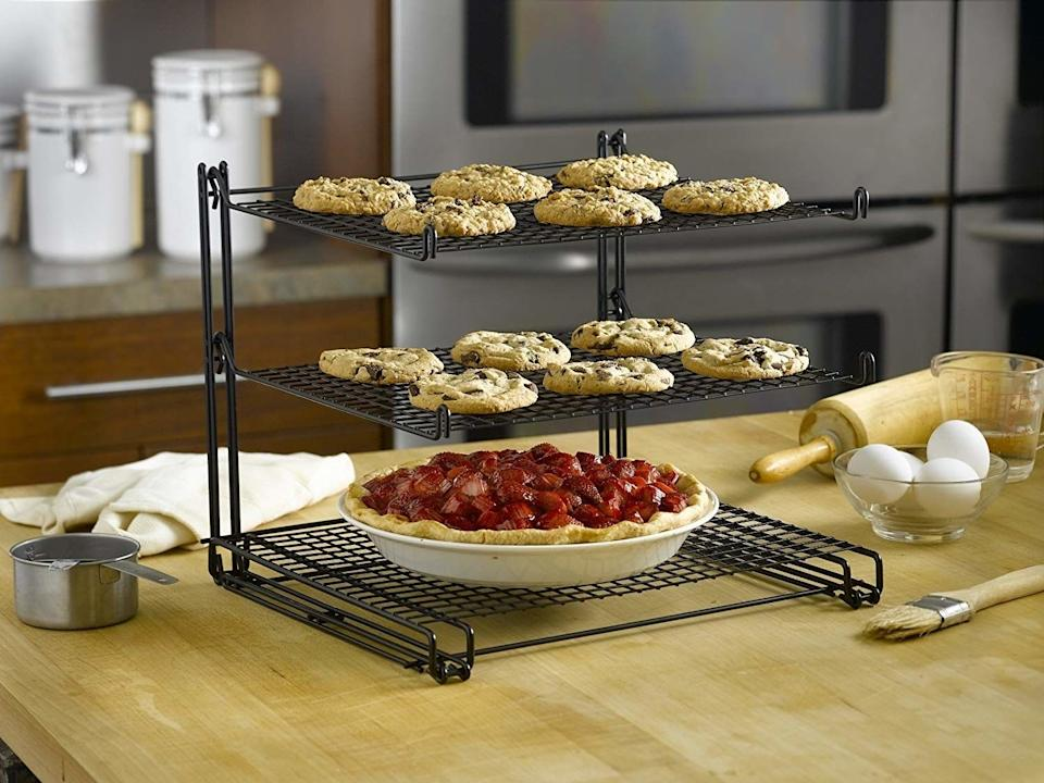 """This is perfect for when you want to cook or bake a bazillion things at once, but don't quite have the counter space for it. This is basically a counter multiplier, y'all.<br /><br /><strong>Promising review:</strong>""""I really like the clever and functional design of this cooling rack,<strong>especially for limited counter space kitchens as mine.</strong>I use this for lightweight baked goods such as cookies and croissants. I have not tried it yet for heavier items such as pies, but for those, just attach the racks on both sides for support.<strong>What I love most is this rack folds up for storage —a clever space-saver when stored too.</strong>All around, great product design with good quality construction. Highly recommend for lightweight baked goods."""" —<a href=""""https://www.amazon.com/gp/customer-reviews/RBGDAR5OFXUJ6?ASIN=B0053FZ6RY&ie=UTF8&linkCode=ll2&tag=huffpost-bfsyndication-20&linkId=9900f78cc71b1b41ddbfeb73aadbac54&language=en_US&ref_=as_li_ss_tl"""" target=""""_blank"""" rel=""""noopener noreferrer"""">myreview</a><br /><br /><strong>Get it from Amazon for<a href=""""https://www.amazon.com/Betty-Crocker-3-tier-Cooling-Rack/dp/B0053FZ6RY?&linkCode=ll1&tag=huffpost-bfsyndication-20&linkId=4cb01e8366ebb4642a3571c31b589a48&language=en_US&ref_=as_li_ss_tl"""" target=""""_blank"""" rel=""""noopener noreferrer"""">$19.99</a>.</strong>"""