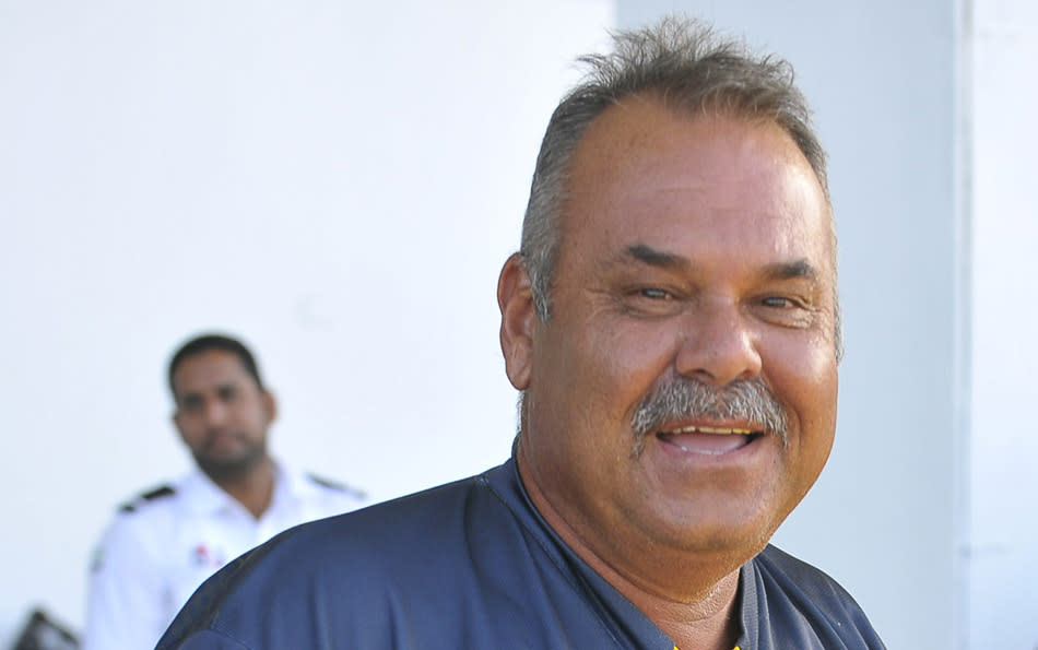 Pakistan's cricket coach Dav Whatmore offers a rare smile after his team won the first Test against South Africa at the Sheikh Zayed Cricket Stadium in Abu Dhabi on October 17, 2013. Wily spinner Saeed Ajmal took four wickets to fire Pakistan to a seven-wicket win over world number one South Africa.  AFP PHOTO/INEKE ZONDAG