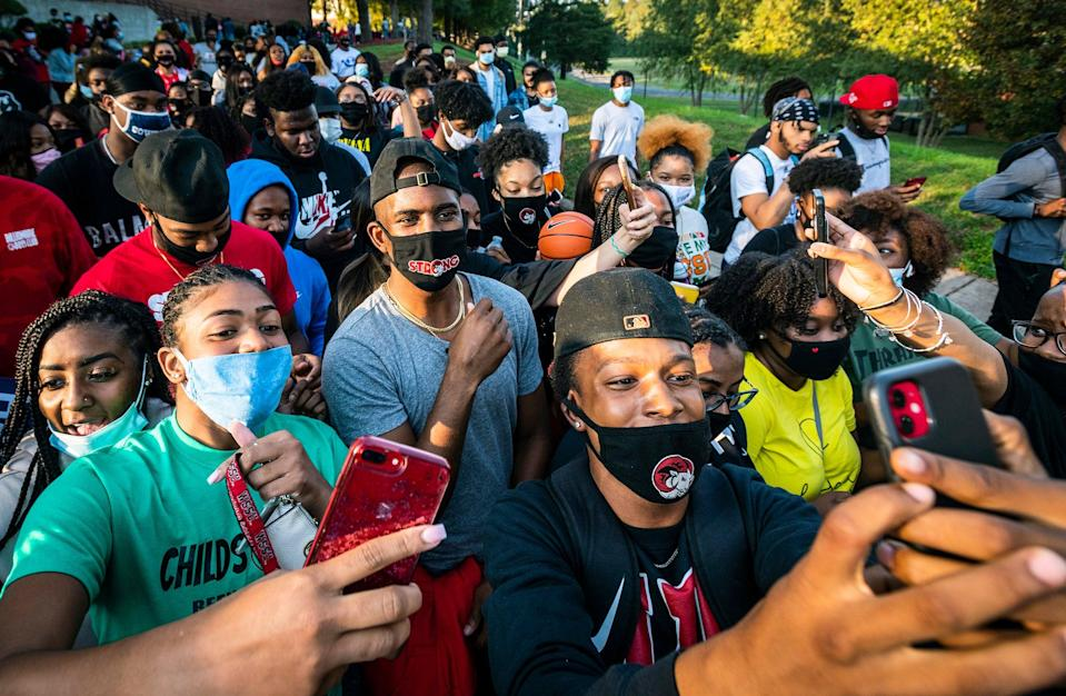 <p>NBA star and current Winston-Salem State University student Chris Paul takes selfies with his fellow Rams as he leads a march to the early voting location on campus on Tuesday, Oct. 27, 2020, in Winston-Salem, North Carolina.</p> (Andrew Dye/The Winston-Salem Journal via AP)