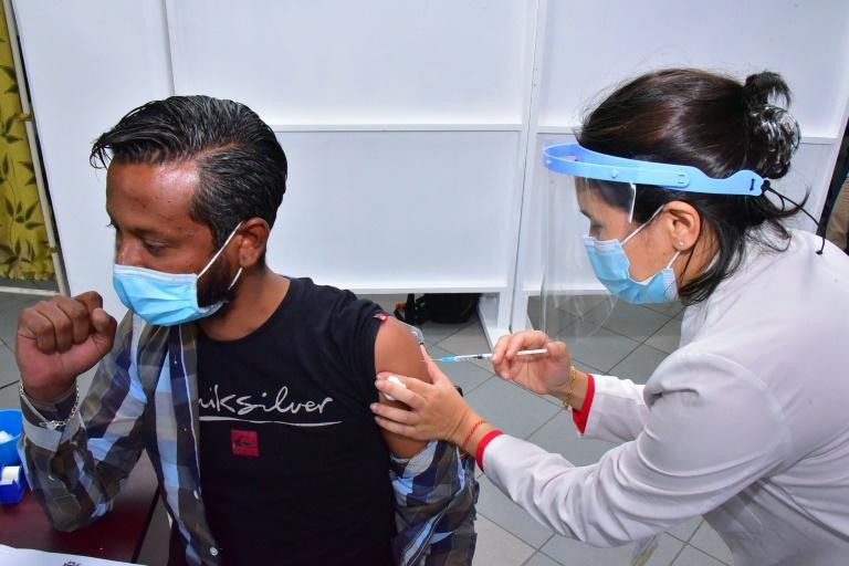 As of Saturday, 61 percent of the population was fully vaccinated (AFP/Rishi ETWAROO)