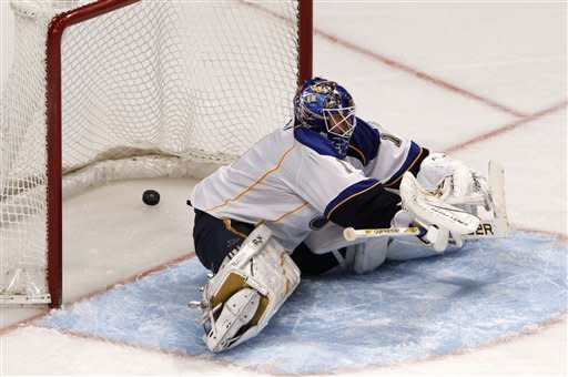 St. Louis Blues goalie Brian Elliott can't stop a shot by Chicago Blackhawks' Duncan Keith during the third period of an NHL hockey game Sunday, Feb. 19, 2012, in Chicago. Chicago won 3-1. (AP Photo/John Smierciak)