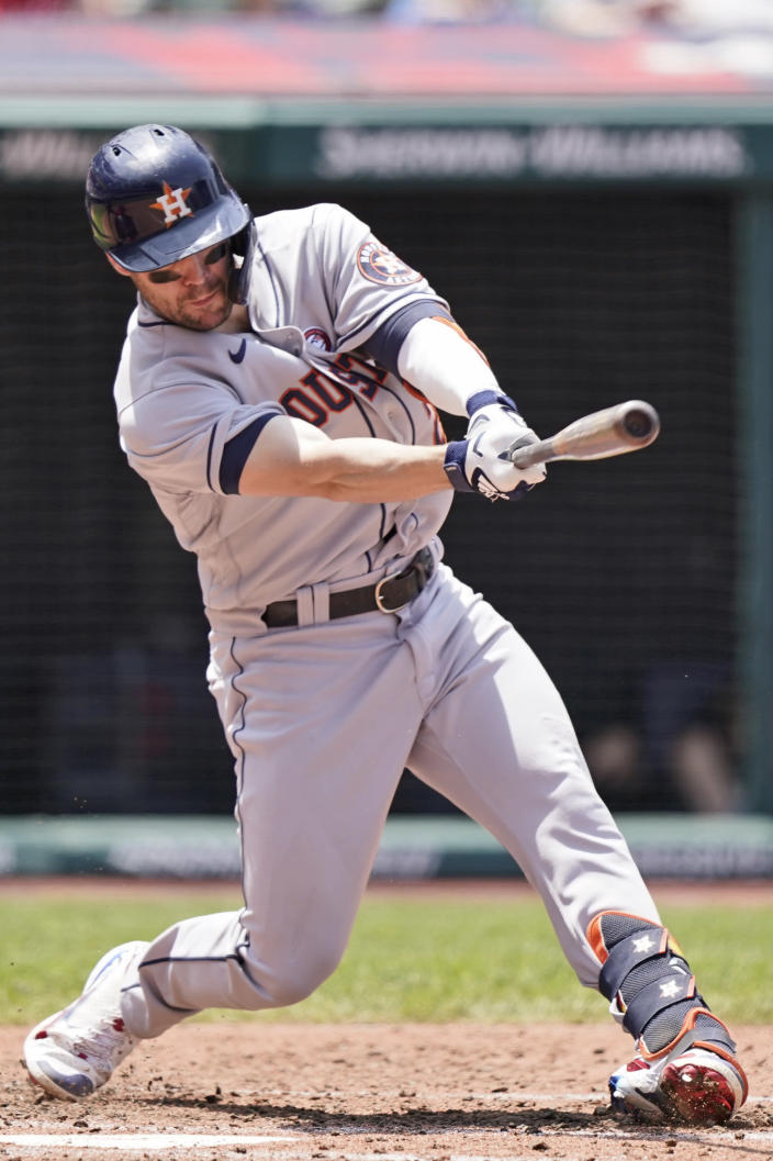 Houston Astros' Chas McCormick hits an RBI-single in the fourth inning of a baseball game against the Cleveland Indians, Sunday, July 4, 2021, in Cleveland. (AP Photo/Tony Dejak)