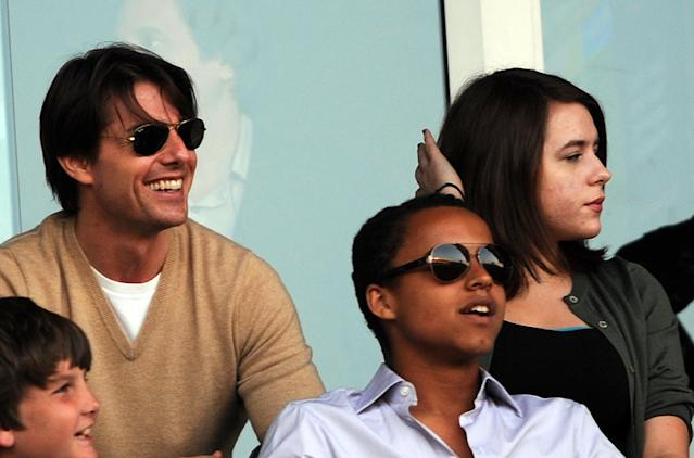 Tom Cruise with Connor and Isabella Cruise at a soccer game in July 2009. They resided with him after his divorce from Nicole Kidman. (Photo: Gabriel Bouys/AFP/Getty Images)