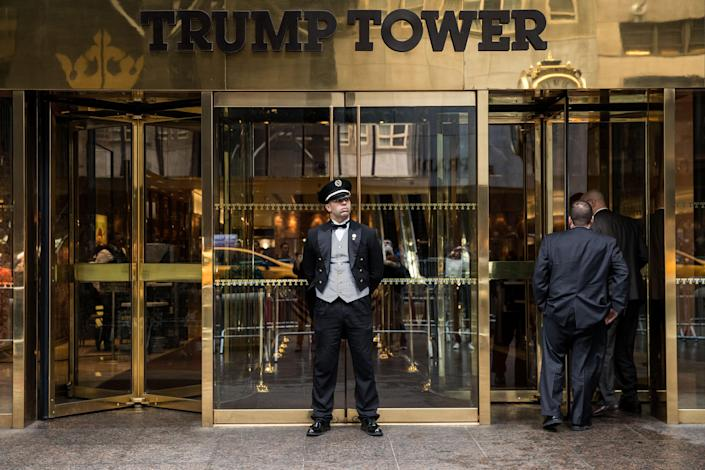 A doorman stands in front of an entrance to Trump Tower in New York City. (Photo: Drew Angerer/Getty Images)