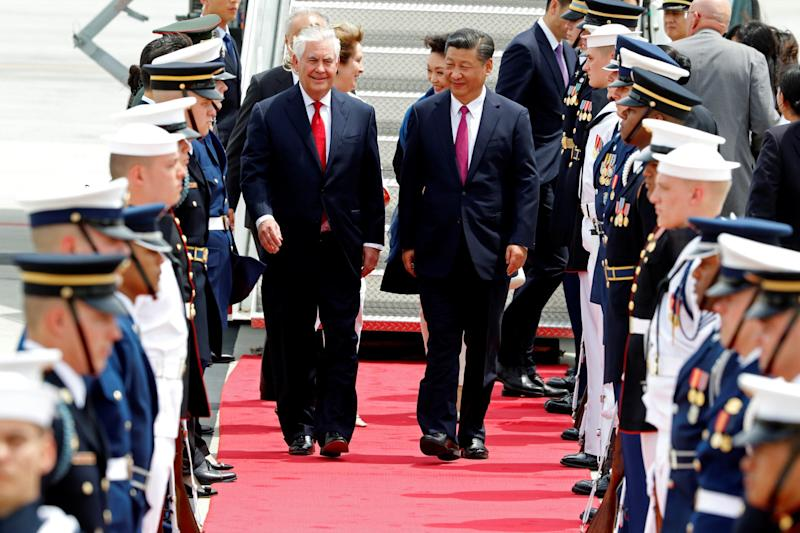 Chinese president Xi Jinping walks with US Secretary of State Rex Tillerson after arriving in Florida: REUTERS