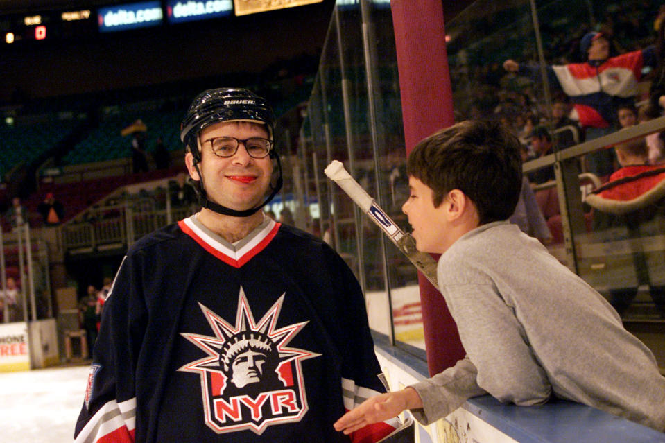 Actor Rick Moranis with his son at the Superskate 2001 charity hockey event at Madison Square Garden in New York City. 01/7/2001 Photo: Evan Agostini/ImageDirect