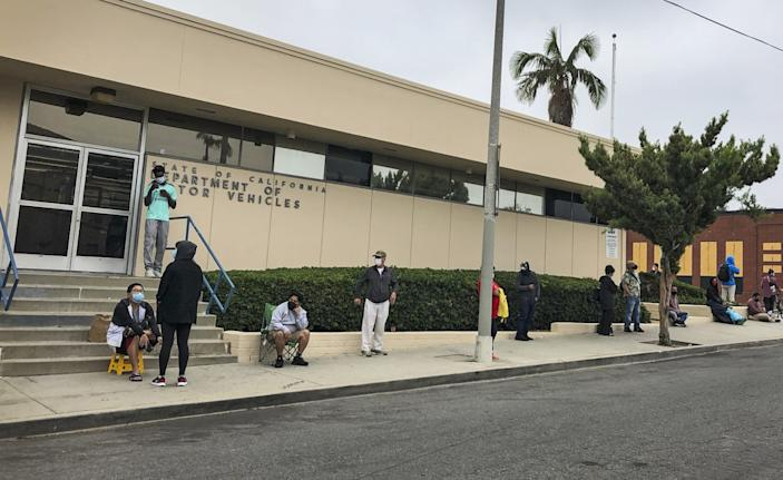 """A look at the line along Waring Avenue at the Hollywood DMV field office at 7:45 a.m. on July 16, 15 minutes before the office opened. The line started at 803 Cole Ave., went down Waring Avenue and then up Wilcox Avenue. It included approximately 140 people by the time the doors opened at 8 a.m. <span class=""""copyright"""">(Adam Tschorn / Los Angeles Times)</span>"""