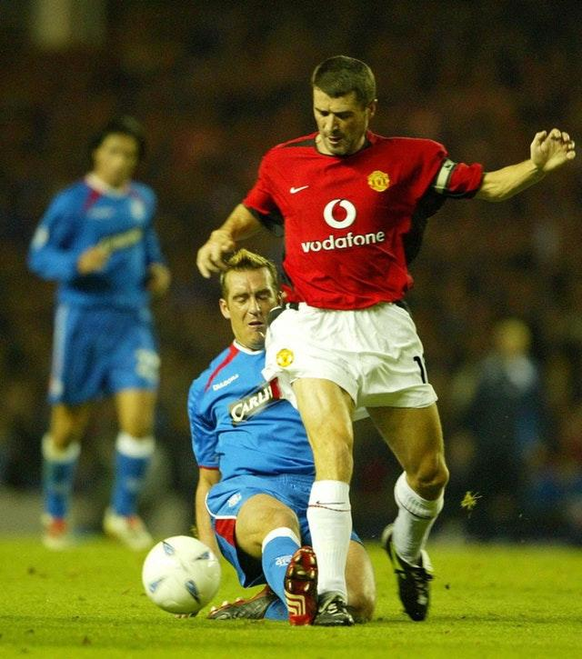 Fernando Ricksen tangles with Roy Keane during a clash with Manchester United