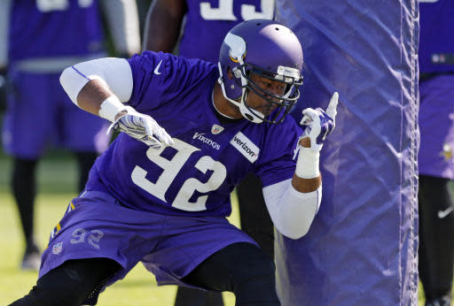 FILE - In this June 6, 2017, file photo, Minnesota Vikings defensive tackle Tom Johnson goes through drills during NFL football practice in Eden Prairie, Minn. The Vikings have signed Johnson on Wednesday, Sep. 19, 2018, bringing back one of their starters last season for more depth up front. (AP Photo/Jim Mone, File)