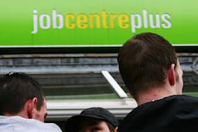 File photo dated 19/03/09 of a group of men outside a Job Centre Plus branch as a shortage of skilled workers in some industries is a