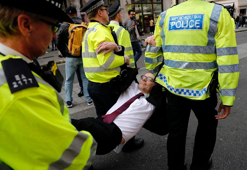 A protester is carried away from Oxford Circus (AP)