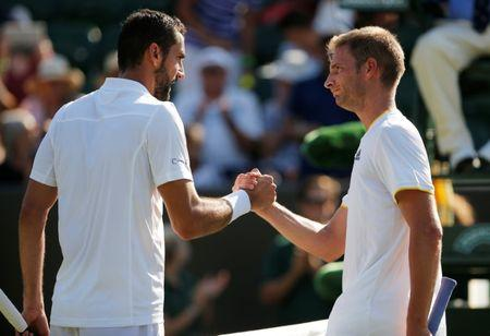 Tennis - Wimbledon - London, Britain - July 5, 2017   Croatia's Marin Cilic with Germany's Florian Mayer after winning their second round match   REUTERS/Andrew Couldridge