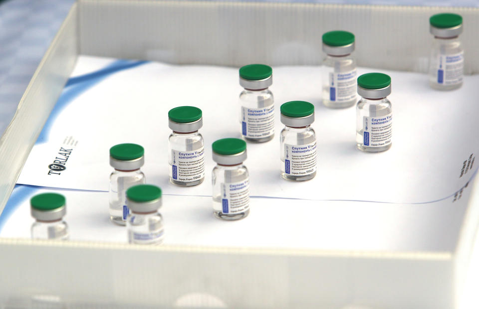 Vials of the Sputnik V vaccine placed on a table prior to the visit of Serbian President Aleksandar Vucic in Belgrade, Serbia, Thursday, April 15, 2021. Serbia has announced it will begin packing and later producing Russia's Sputnik V coronavirus vaccine, which would make it the first European state outside Russia and Belarus to begin manufacturing the jab. (AP Photo/Darko Vojinovic)