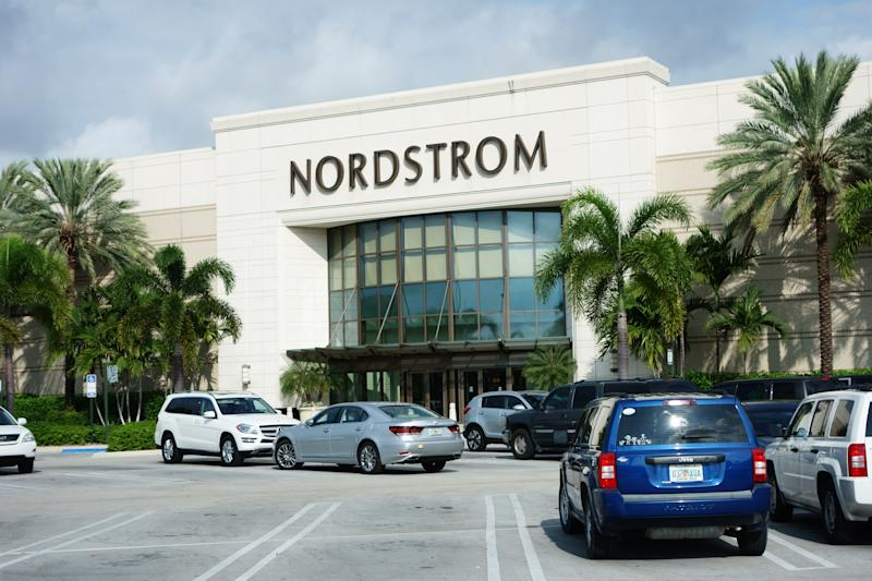 West Palm Beach, USA - October 23, 2013: Nordstrom retail store at a suburban shopping mall. Nordstrom is a national chain of department stores that offers apparel, shoes, jewelry, cosmetics and accessories for women, men and kids. Nordstrom carries most popular designer brands. There are vehicles in the parking lot.
