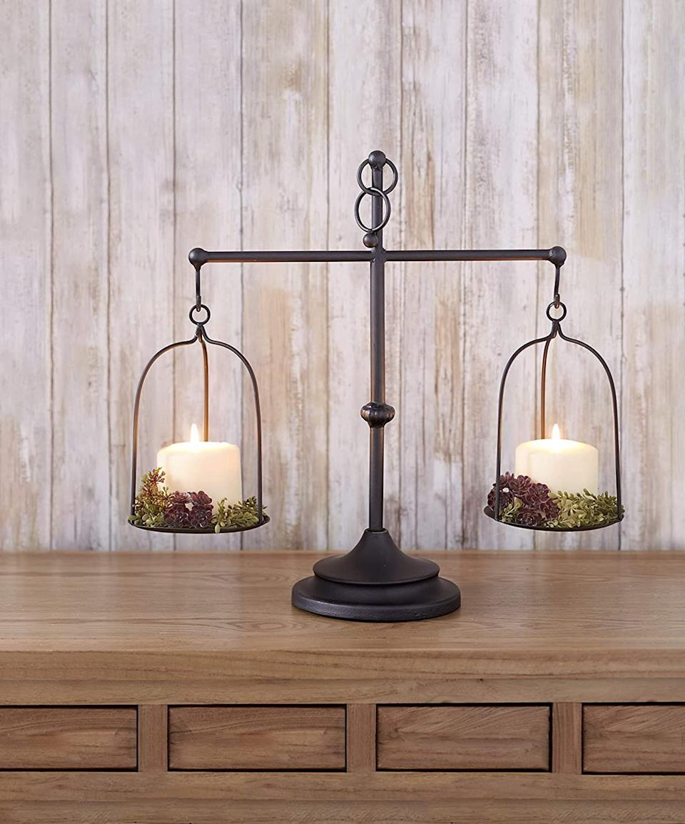 """This candleholder will definitely be the center of attention — it's vintage-inspired and sure to make a statement. And everything looks better by candlelight anyway. <a href=""""https://amzn.to/3jb4wIr"""" target=""""_blank"""" rel=""""noopener noreferrer"""">Find it for $17 at Amazon</a>."""