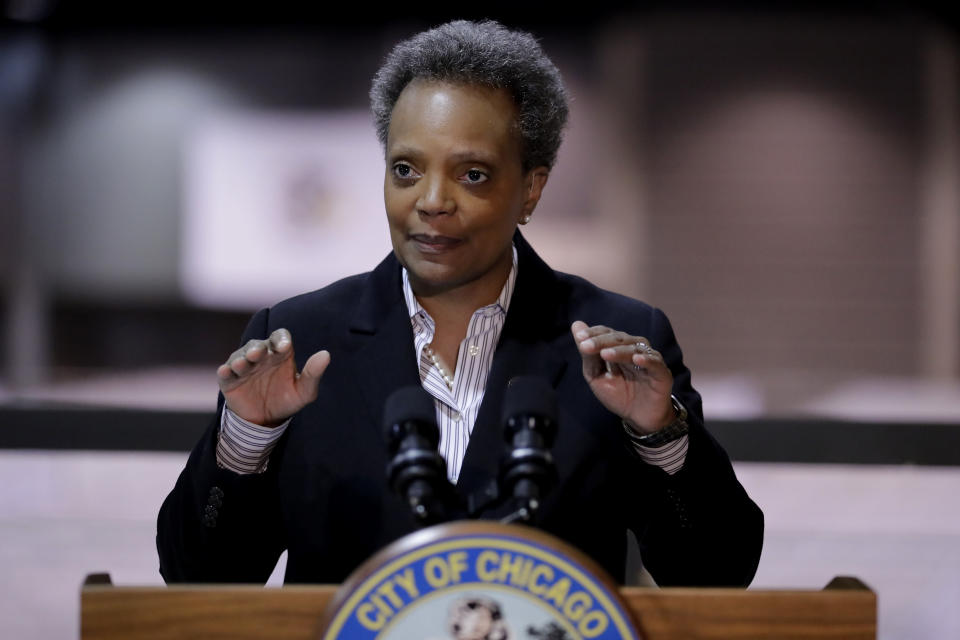 FILE - In this April 10, 2020, file photo Chicago Mayor Lori Lightfoot speaks during a news conference in Hall A at the COVID-19 alternate site at McCormick Place in Chicago. As the coronavirus and protests against police brutality have swept the nation, black female mayors including Atlanta's Keisha Lance Bottoms and Chicago's Lori Lightfoot have led the charge..(AP Photo/Nam Y. Huh, File)