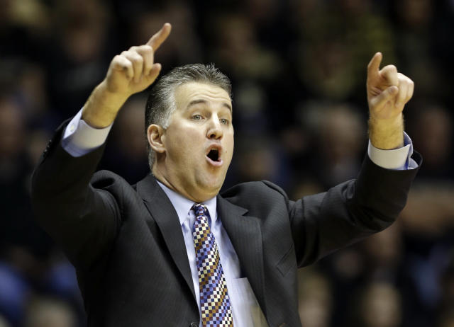Purdue head coach Matt Painter calls a play for his team as they play Nebraska in the second half of an NCAA college basketball game in West Lafayette, Ind., Sunday, Jan. 12, 2014. Purdue defeated Nebraska 70-64. (AP Photo/Michael Conroy)