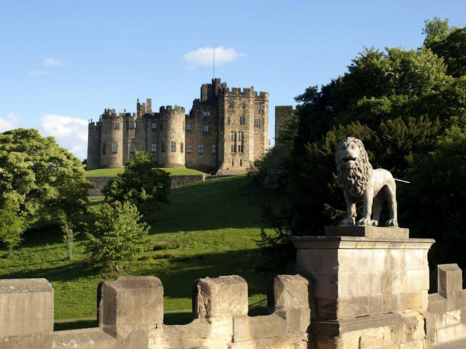 """<p>This Northumberland county castle has been around since 1309, and <a href=""""https://www.alnwickcastle.com"""" rel=""""nofollow noopener"""" target=""""_blank"""" data-ylk=""""slk:many parts of the castle"""" class=""""link rapid-noclick-resp"""">many parts of the castle</a> were even used during the filming of several of the <em>Harry Potter</em> films. 'Kay so Hogwarts isn't a real place, but this is as close as you'll get.</p>"""